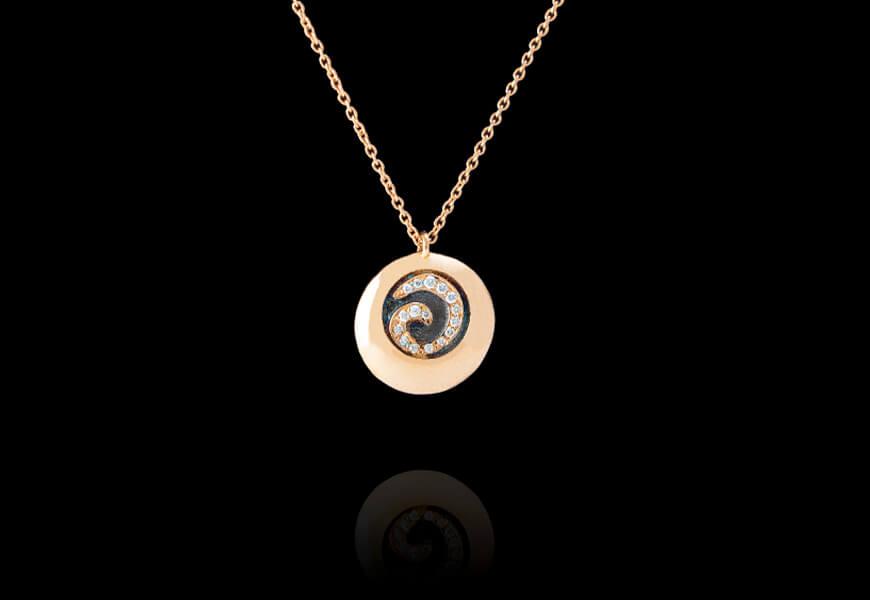 Ciondolo con spirale di diamanti e oro