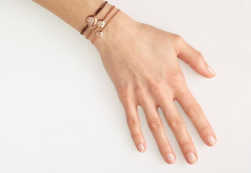 Braccialetto in oro rosa con cuore e diamanti